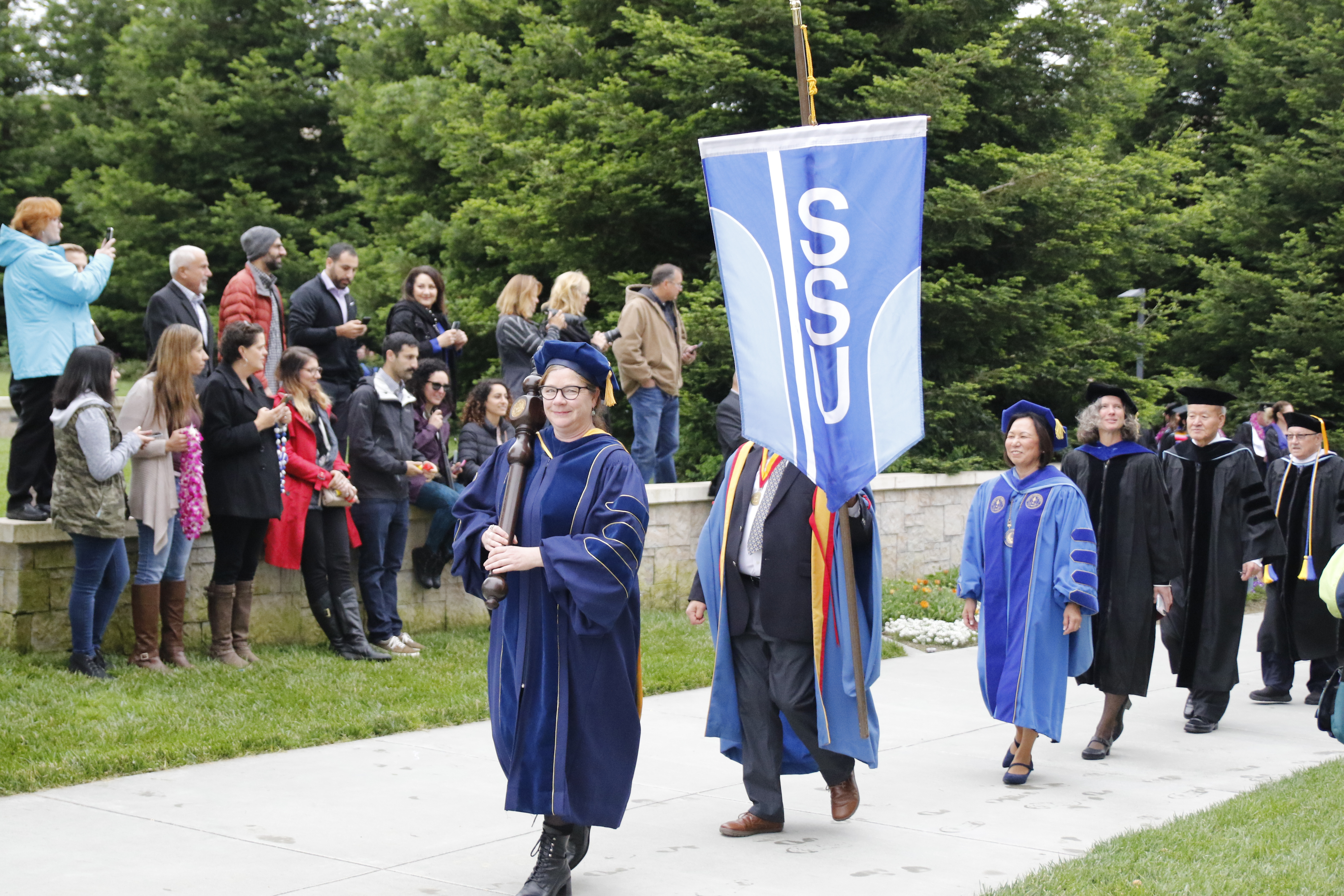 Processional of faculty with SSU banner at commencement