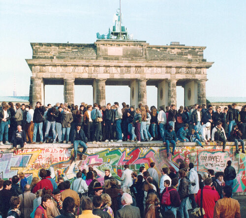 Large groups of people at Berlin Wall