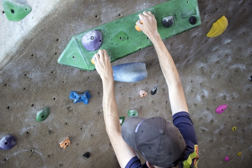 Man climbing rockwall