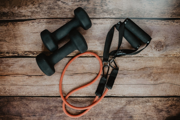 Black and orange workout equipment on top of wood slats
