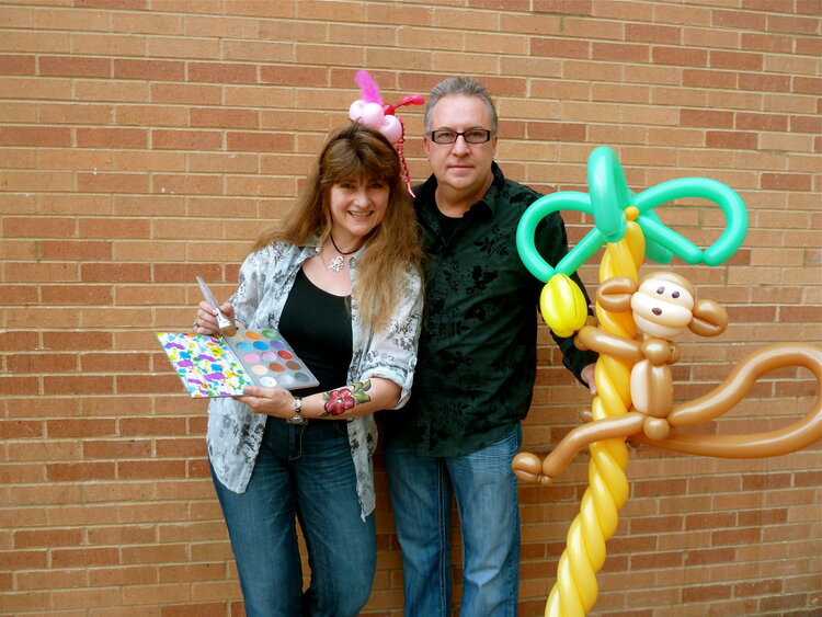 People posing with balloon animals