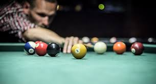 Guy playing pool