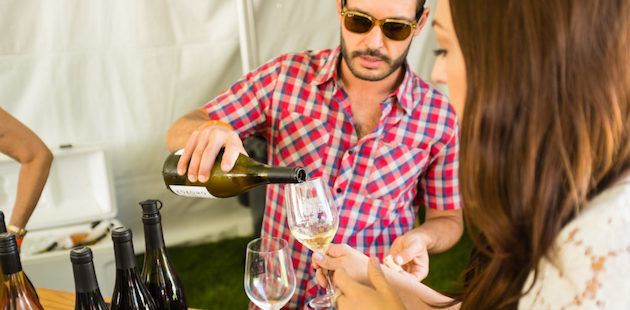 Guy pouring wine