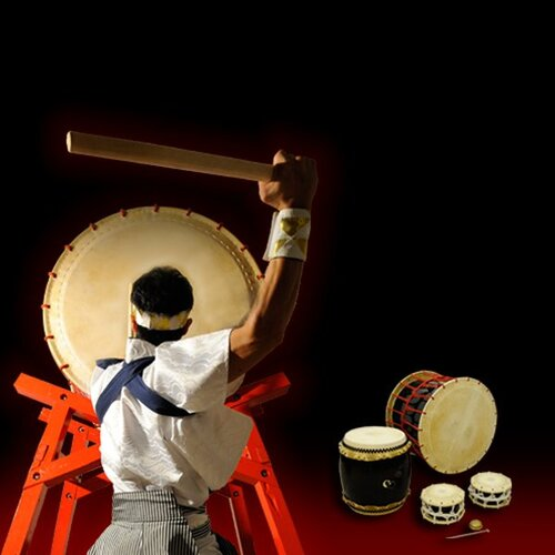 The back of someone beating a Taiko drum
