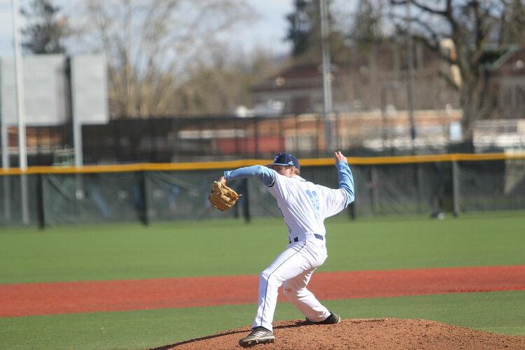 Student pitching a baseball