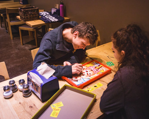 Student playing a board game