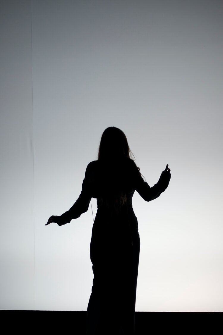 Black and white photo of the silhouette of someone dancing