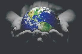 hands holding the globe