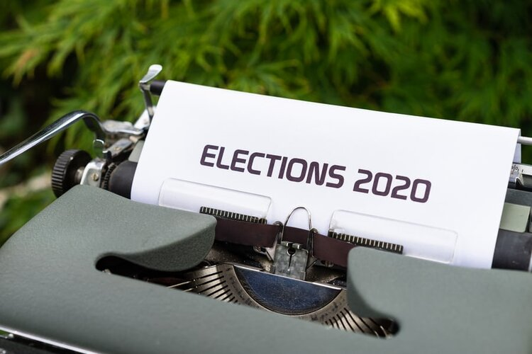 "A grey typewriter with paper with text on it that reads ""Elections 2020"""