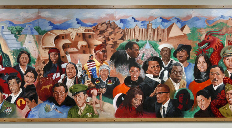 The Ethnic Studies mural featuring portraits of important historical figures
