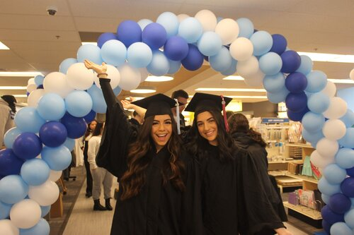 Students at the grad fair in cap and gown