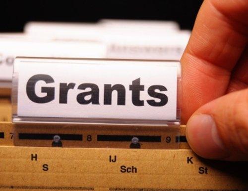 "Folder labeled as ""Grants"""