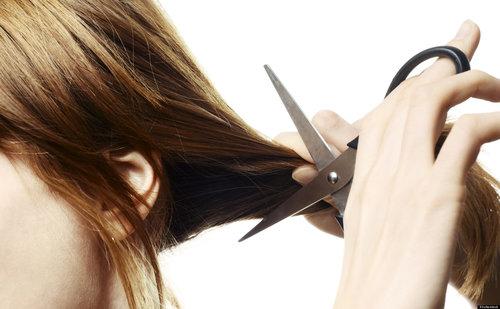 A person cutting hair