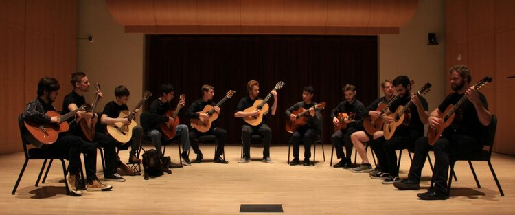 Group of people playing guitars