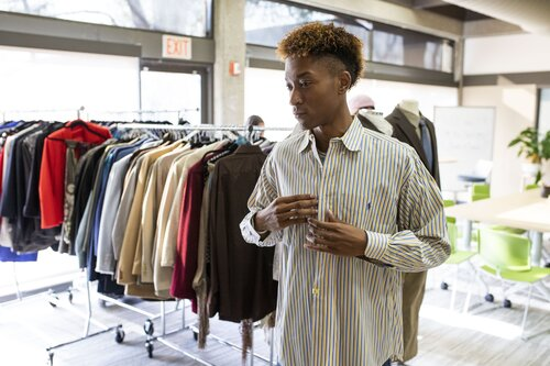 Student trying on business clothes
