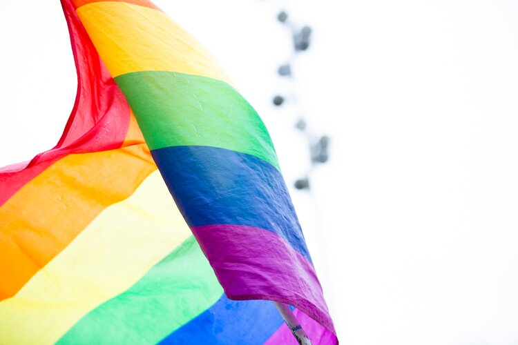 The rainbow LGBTQIA flag flapping in the wind