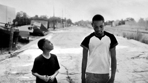 Teenager and kid walking