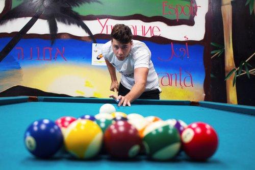 Student playing pool