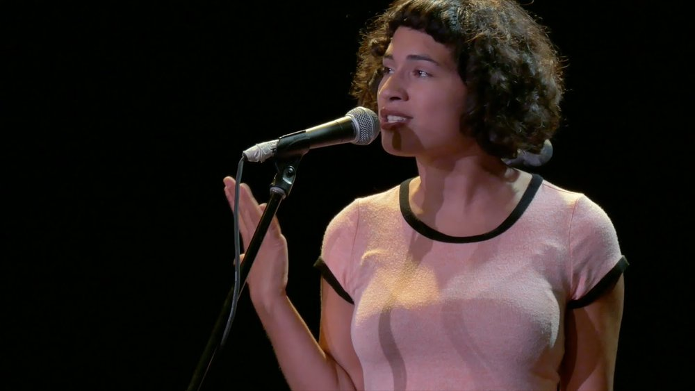 Women speaking into a microphone