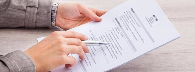 A person editing a resume