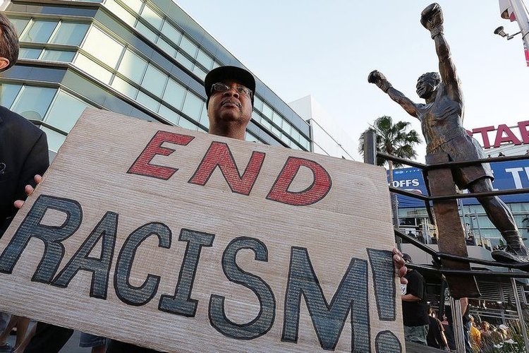 Person holding sign