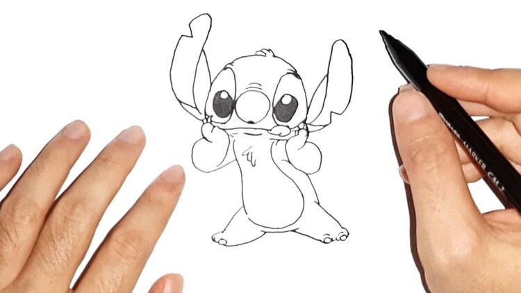 Two hands drawing the Disney character Stitch
