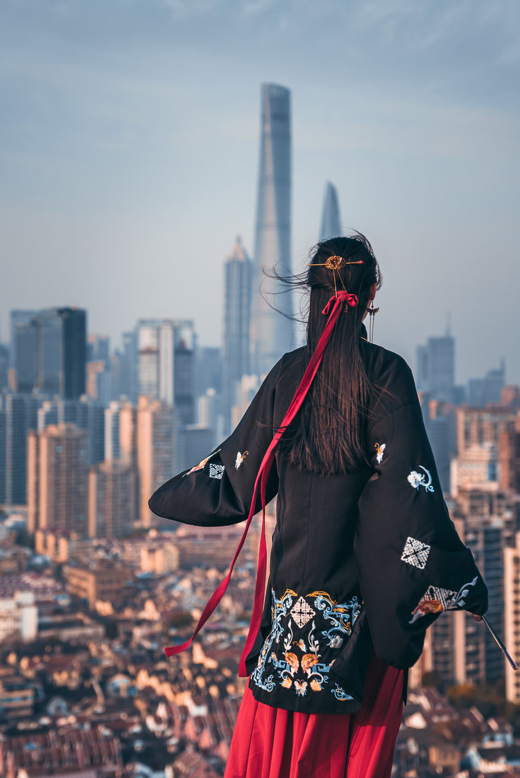 Woman looking into city