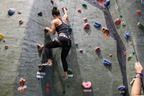 Woman climbing a rock