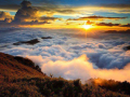 Colorful clouds rolling over hills during sunset or sunrise
