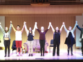 Students standing on a stage